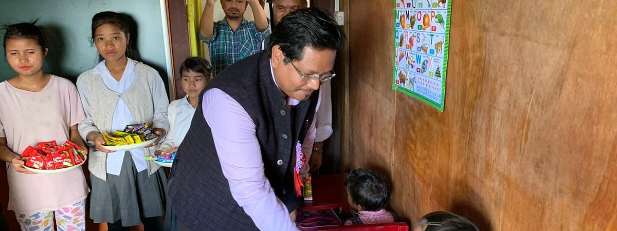 Meghalaya chief minister Conrad K Sangma interacting with students at Shohphria Govt LP School in Nongstoin