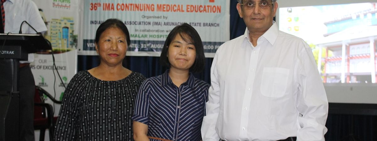 Mumni Tayeng (middle) with her mother (left) and doctor
