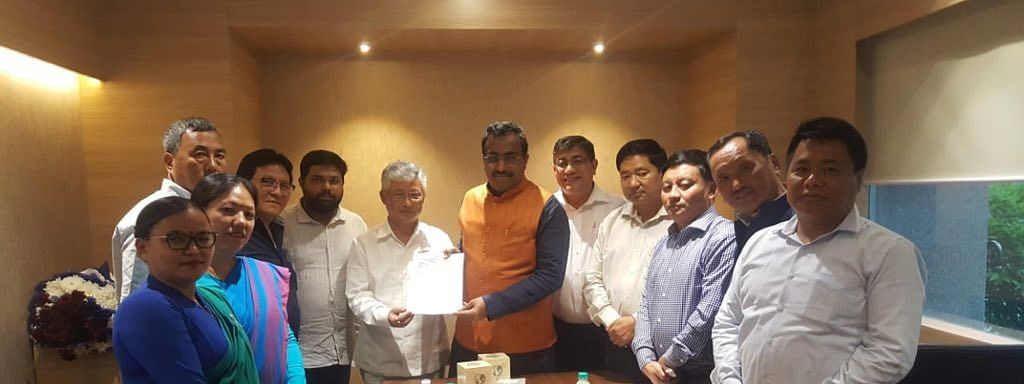 10 of the 13 Sikkim Democratic Front MLAs seen in a picture with BJP leader Ram Madhav in New Delhi