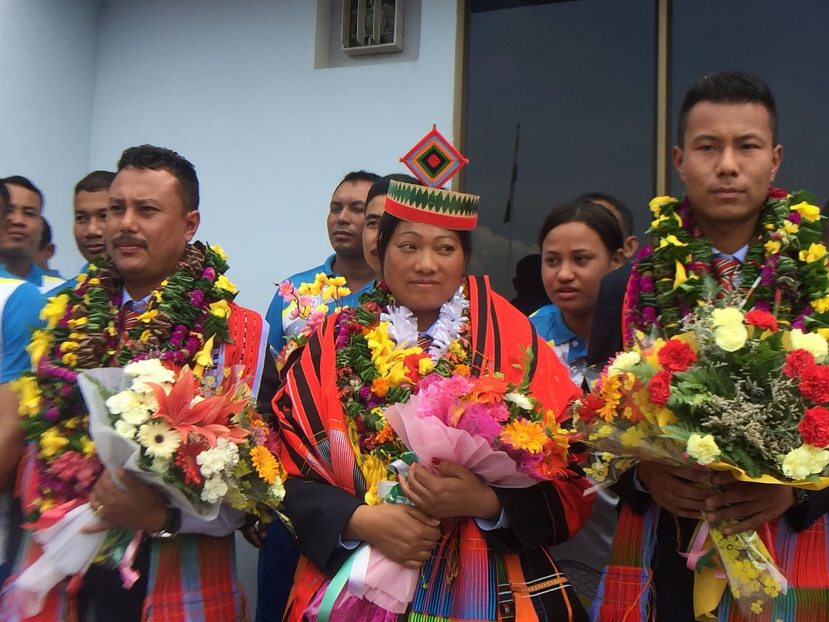 Outer Manipur MP Dr Lorho S Pfoze felicitating rank holders at Don Bosco College, Maram in Senapati