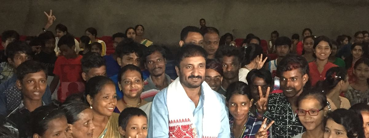 Patna-based educator and mathematician Anand Kumar poses with children from slum areas and childcare homes in Guwahati, Assam on Monday