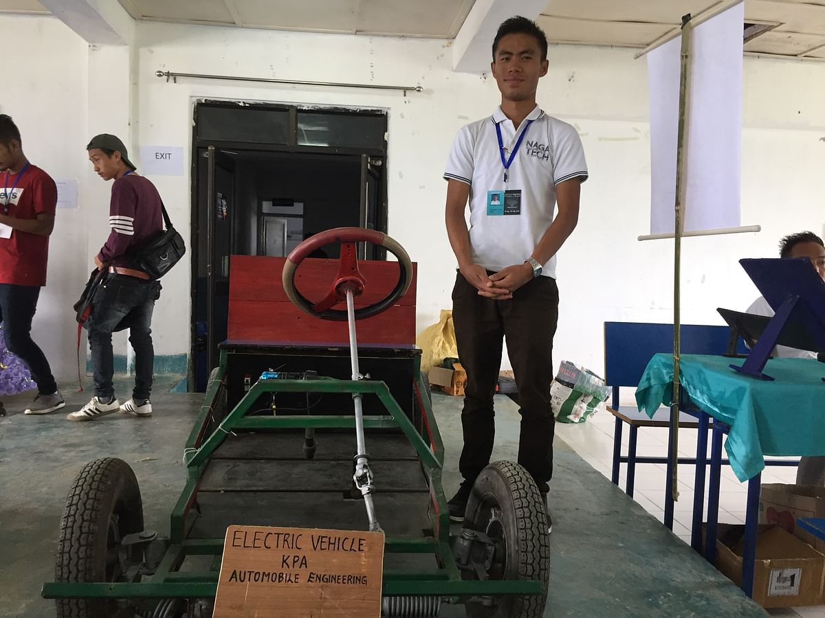 Ponchan Kikon, leader of a 13-member team from KPA, poses with the 'electric vehicle' during Tech Fest in Kohima, Nagaland
