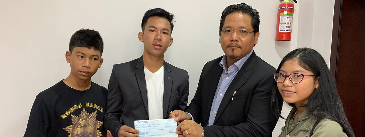 The three siblings with Meghalaya chief minister Conrad K Sangma in Shillong donating their savings to the CM's Relief Fund
