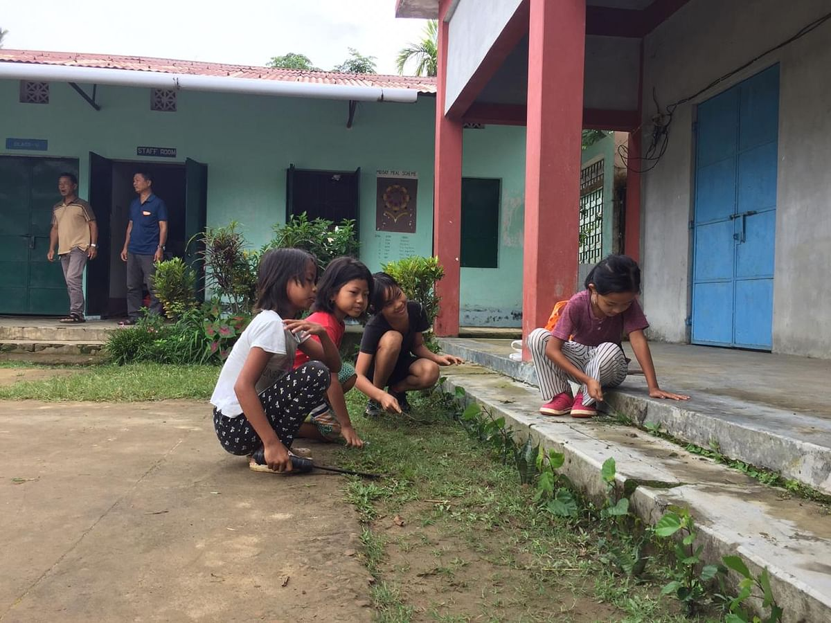 Students of Vanghmun Primary School cleaning the premises of the institution