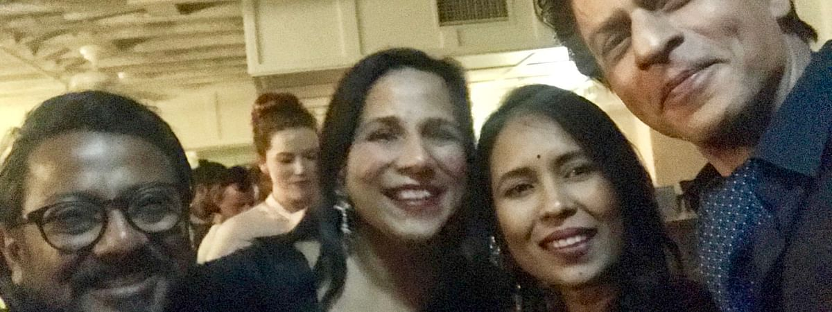 Rima Das with Bollywood superstar Shah Rukh Khan at the 2019 Indian Film Festival of Melbourne in Australia