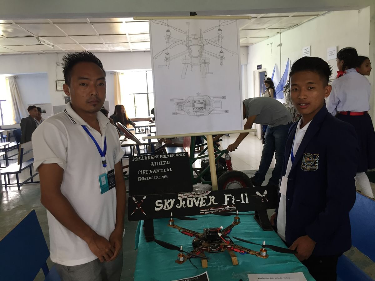 Mhademo Odyuo (left) and Philip Tep, mechanical engineering students from Khelhoshe Polytechnic Atoizu, posing with their 'Sky Hover Fi-II' -- a handcrafted bamboo drone
