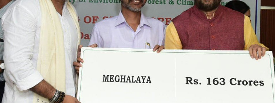 Union minister Prakash Javadekar (right) handing over the cheque to Meghalaya's forest and environment minister Lahkmen Rymbui (middle)