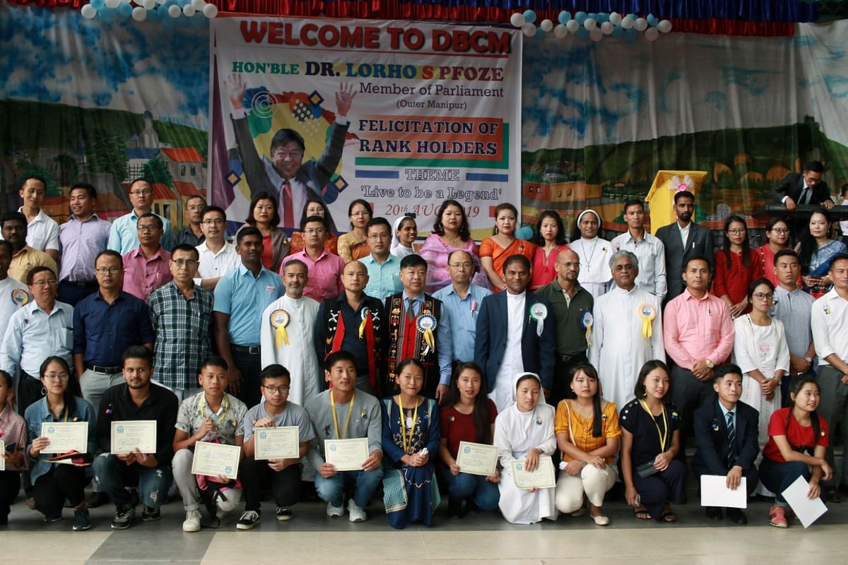 Outer Manipur MP Dr Lorho S Pfoze along with the rank holders, faculty members and non-teaching staff of Don Bosco College, Maram