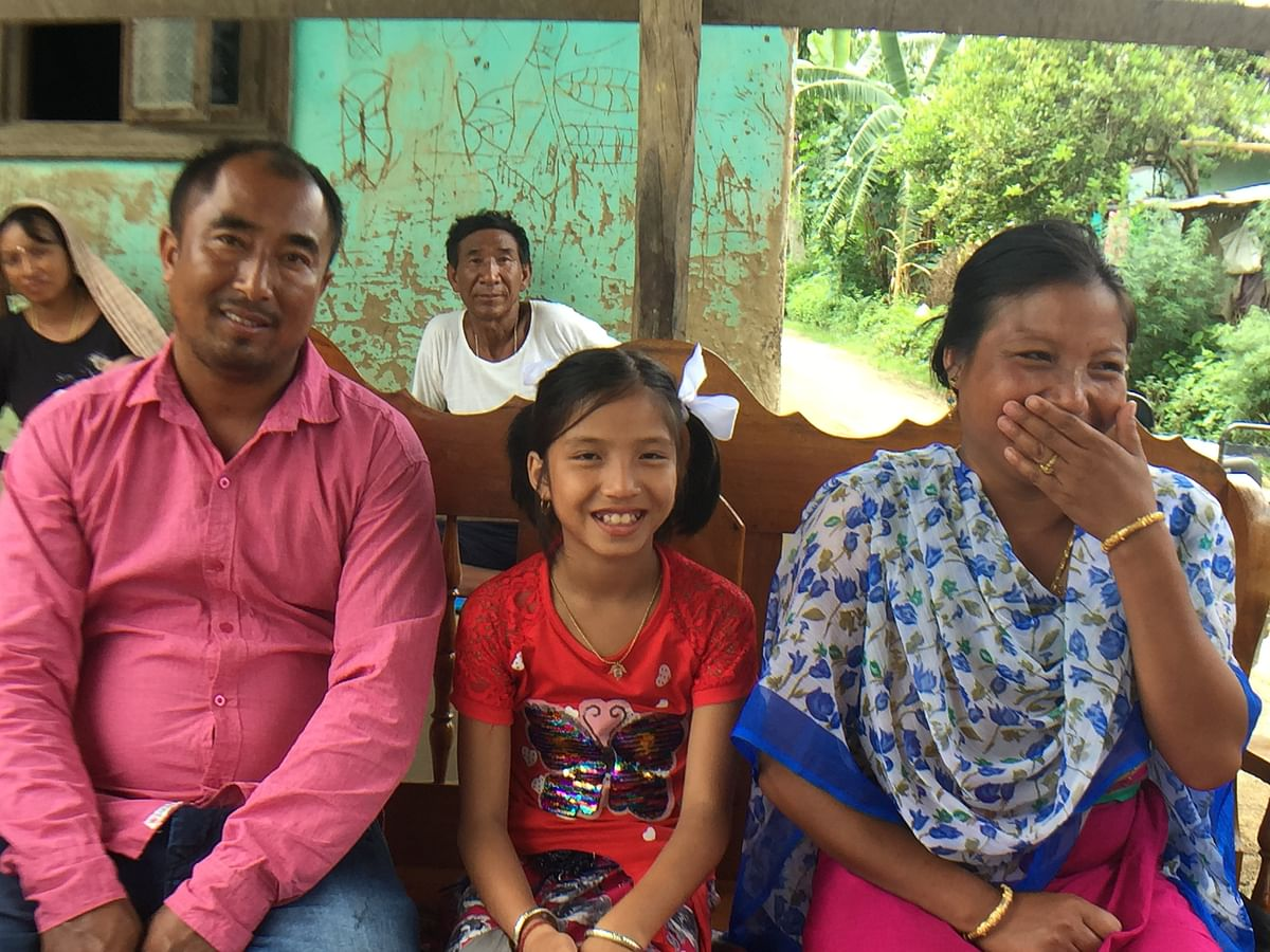 Valentina Elangbam Devi with her parents in Kakching, Manipur