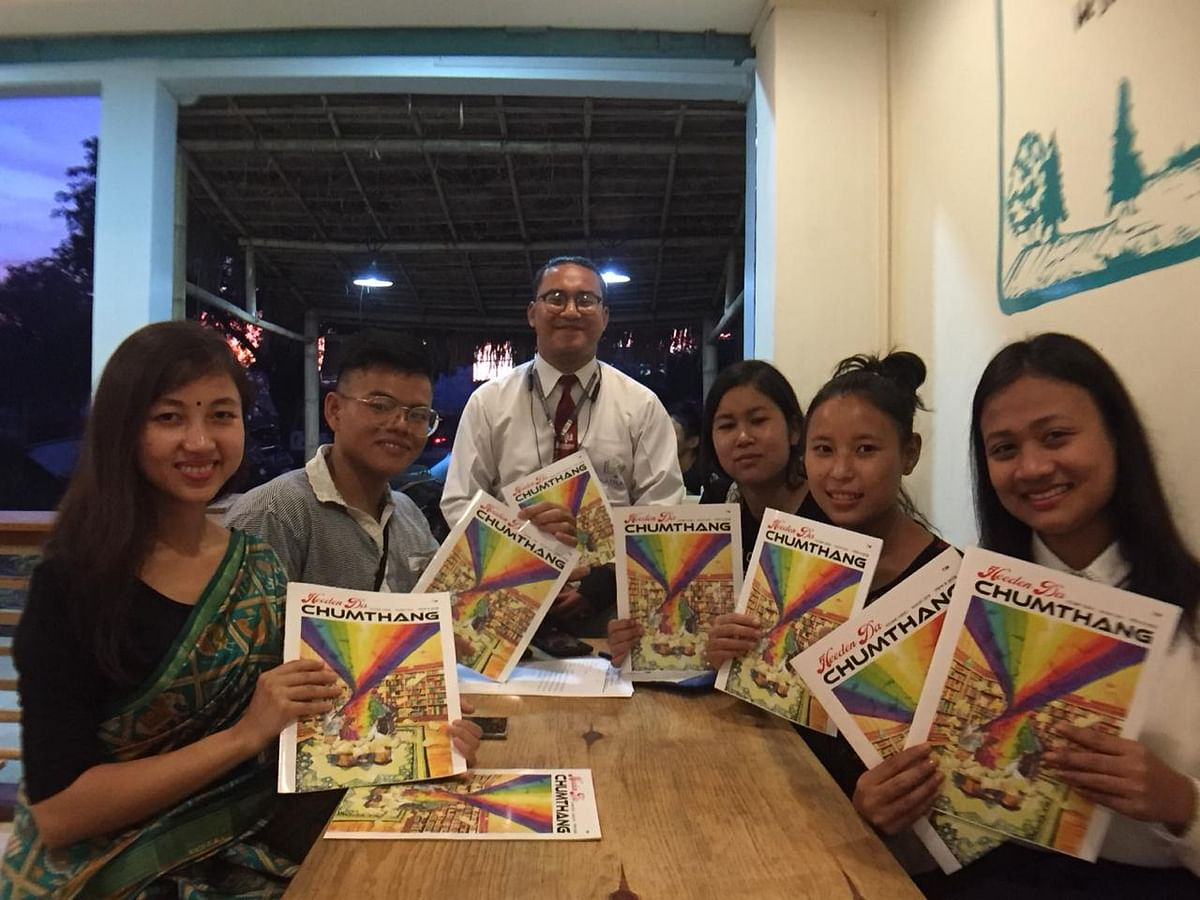 Pooja Elangbam and the core team members showcasing the newly launched magazine, 'Heeden da Chumthang'