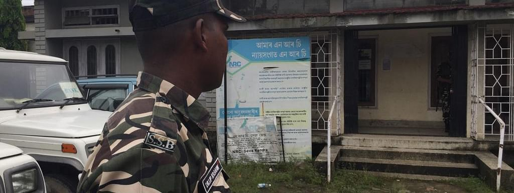 A security man stands guard at an NSK Seva Kendra in Guwahati, Assam on Saturday morning