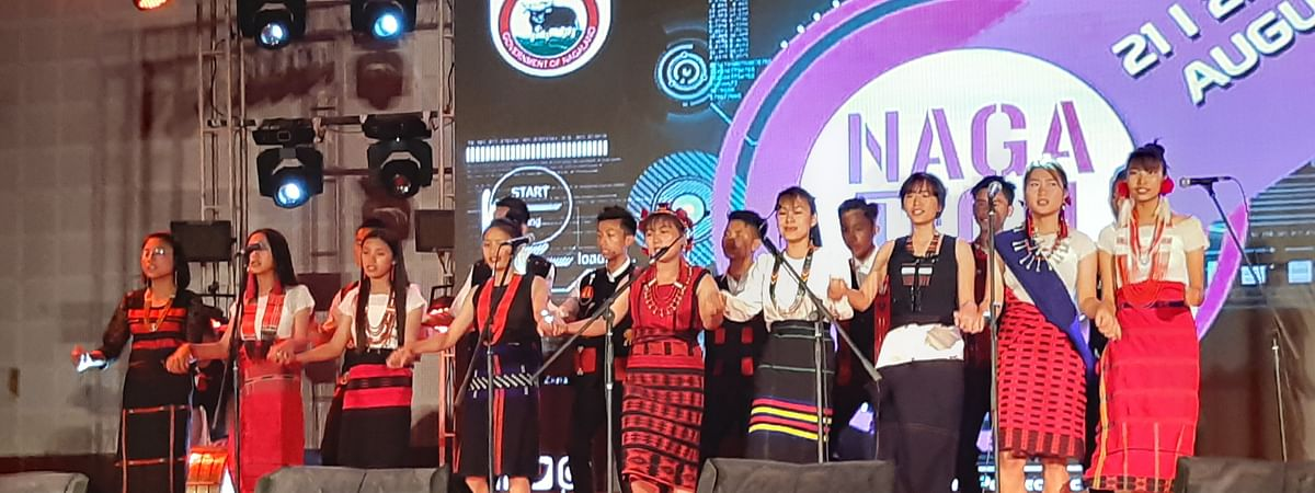 Students clad in traditional Naga attire presenting a song in honour of Nagaland higher education and technical education minister Temjen Imna Along