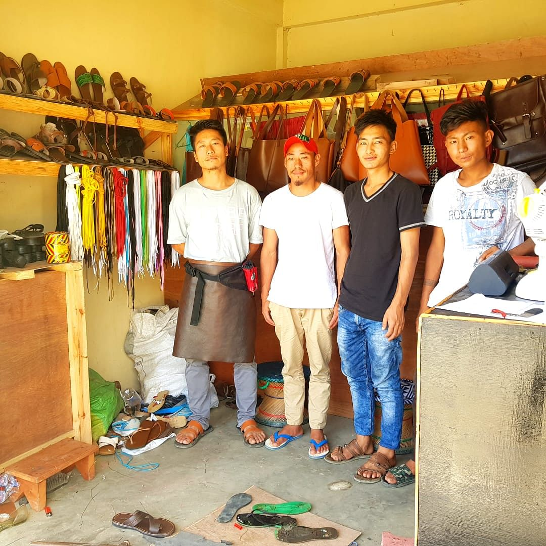 Toyi Swuro (extreme left) with his friends -- Kudengoyi Lohe, Thupudayi Chizo and Muralho -- at Craft Gallery in Phek district of Nagaland