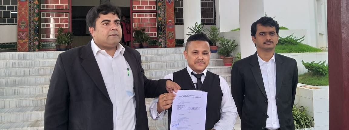 Advocate S Chatterjee (left) with petitioner Nawin Kiran Pradhan (middle) outside Sikkim Legislative Assembly on Friday