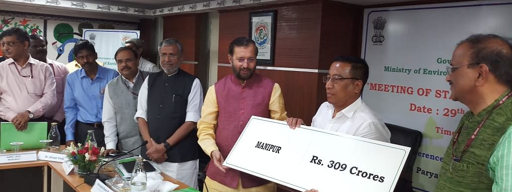 Union minister Prakash Javadekar handing over a cheque of Rs 309 crore to Manipur forest and environment minister Th Shyamkumar Singh
