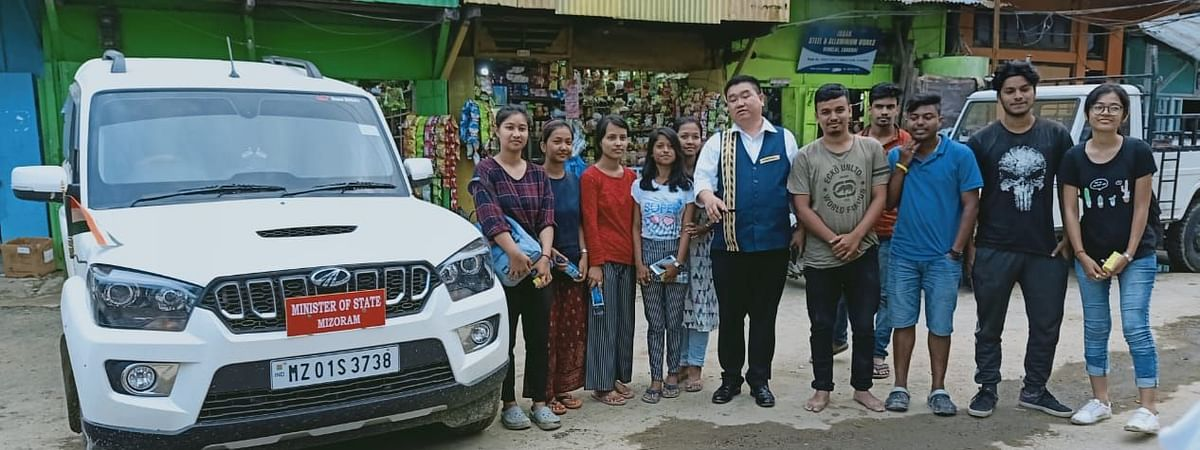 Stranded students with Mizoram information and public relations minister Lalruatkima in Mualkhang in Kolasib district