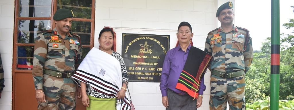 The parents of late Captain Neikezhakuo Kenguruse along with officials of Assam Rifles outside the memorial hall at Pheza village in Kohima, Nagaland