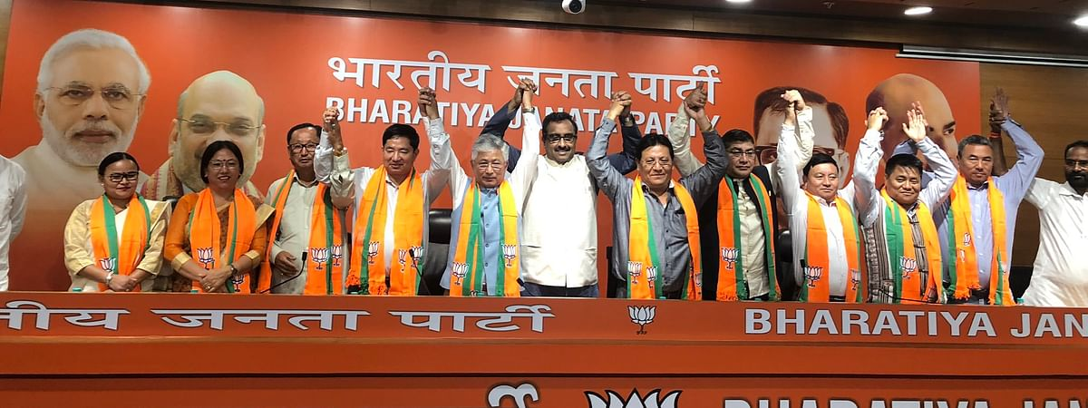 The 10 MLAs of the Sikkim Democratic Front with BJP working president JP Nadda and senior BJP leader Ram Madhav in New Delhi on Tuesday