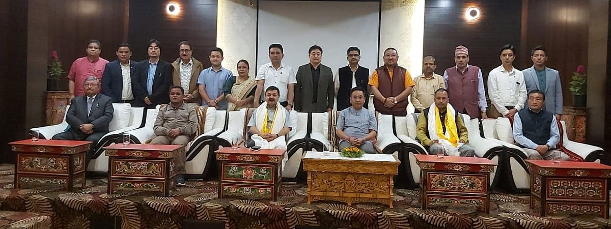 The two former SDF MLAs seen with Sikkim chief minister and SKM president Prem Singh Golay and the other 16 elected MLAs