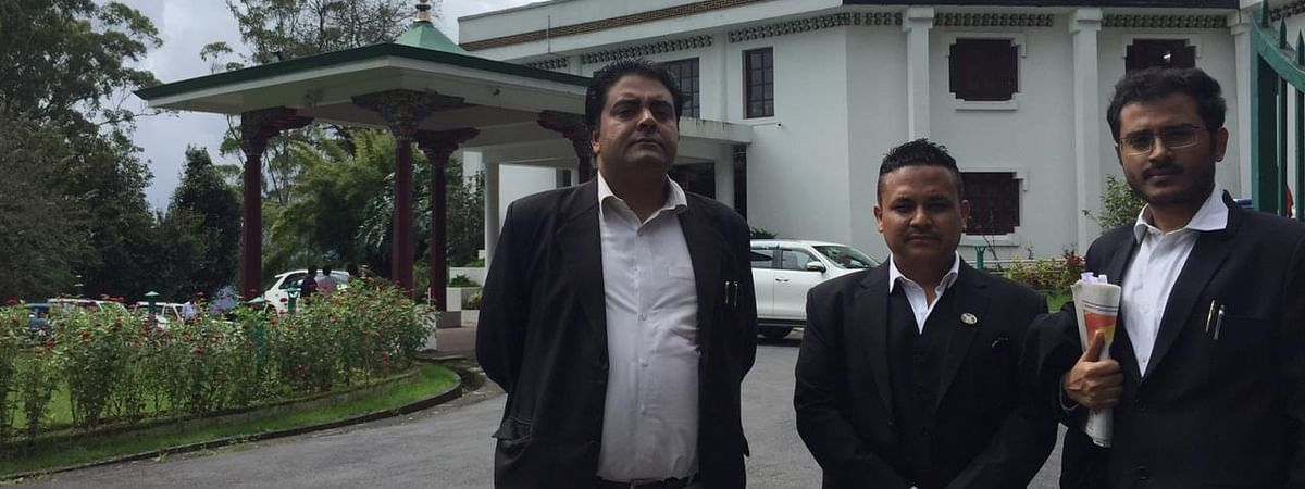 Advocate S Chatterjee (left) with petitioner Nawin Kiran Pradhan (middle) outside Sikkim Legislative Assembly on Tuesday