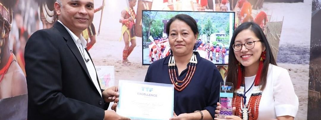 Deputy director KM Rio (middle) and tourist officer Diana Achumi (right) receiving the award on behalf of the Nagaland tourism department