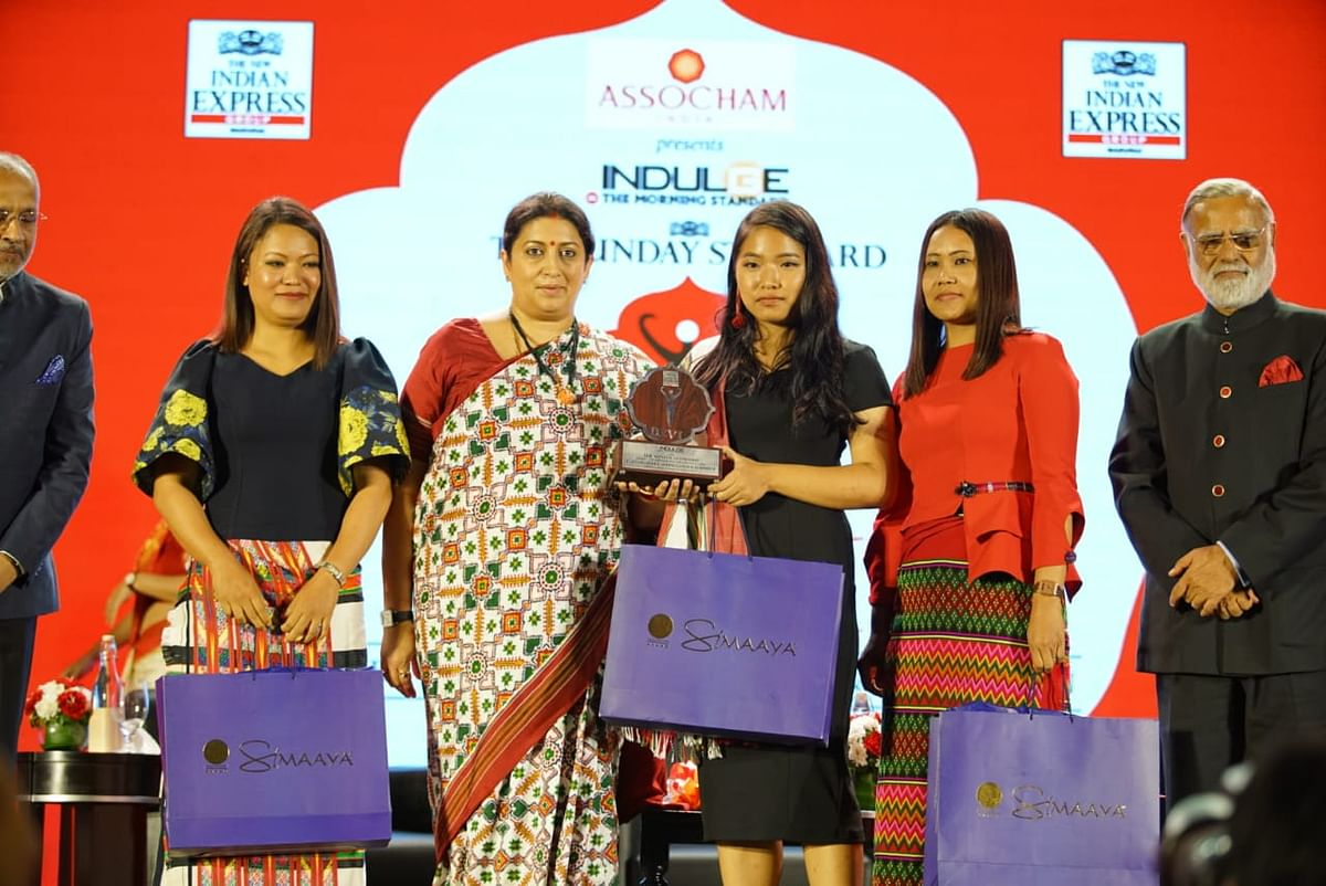 Mizoram sisters Laldinsangi, Lalsangzeli and Lalrinpuii also received the Devi Award for transforming women's fashion; seen here with Union minister for textiles and women & child development Smriti Z Irani