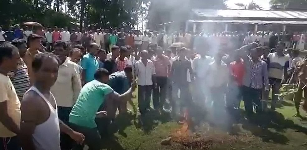 Villagers burning effigy of NRC state coordinator Prateek Hajela in Nagaon district on Thursday