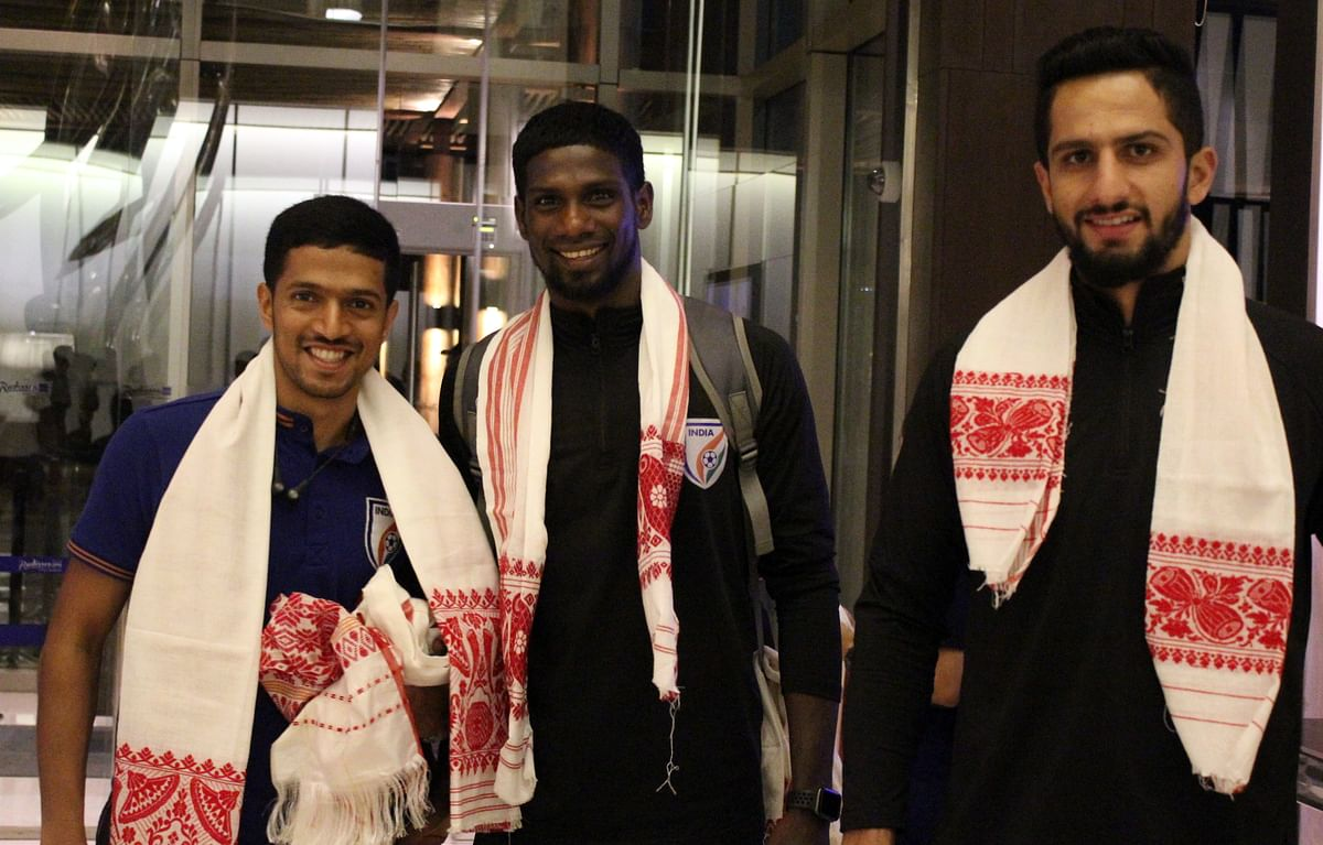 Indian team members being greeted with traditional Assamese 'gamusa' upon their arrival at Guwahati airport in Assam