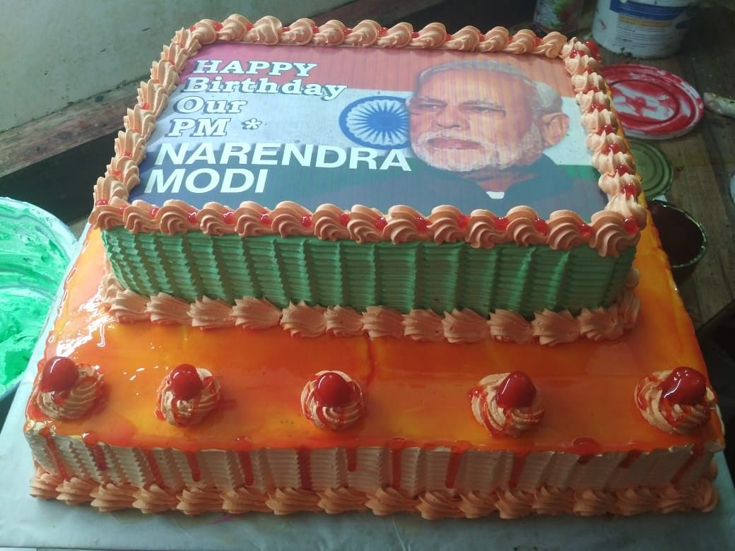 The cake that was brought in to celebrate PM Narendra Modi's 69th birthday in Tinsukia, Assam on Tuesday