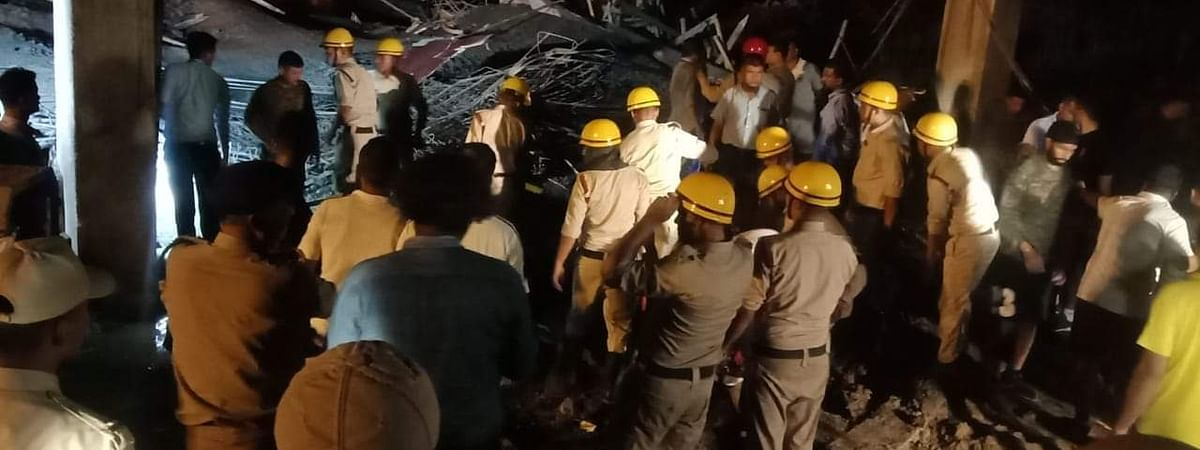 Rescue team searching and rescuing injured workers after an under-construction building collapsed at Bir Tikendrajit International Airport in Imphal, Manipur on Wednesday evening