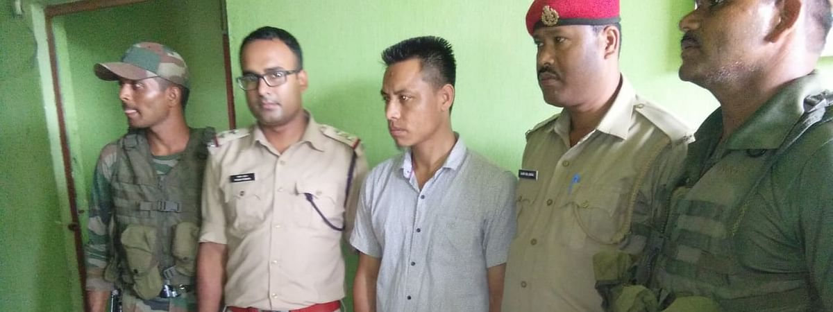 The arrested PDCK cadre (centre) has been identified as Sukursing Millick, a native of Dengaon area under Dokmoka police station of Assam's Karbi Anglong district