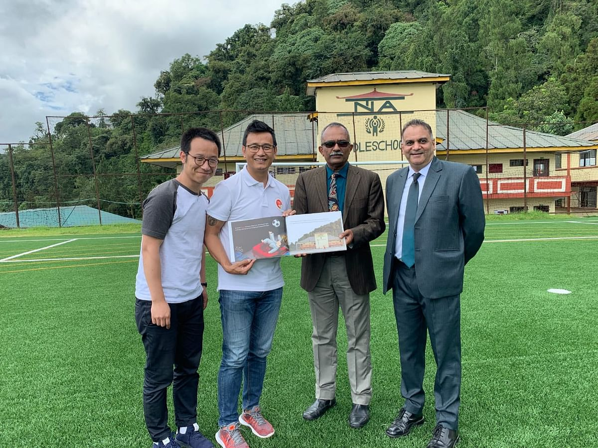 Former Indian footballer Bhaichung Bhutia (second from right) with his 'Sir' Lenny (extreme right)