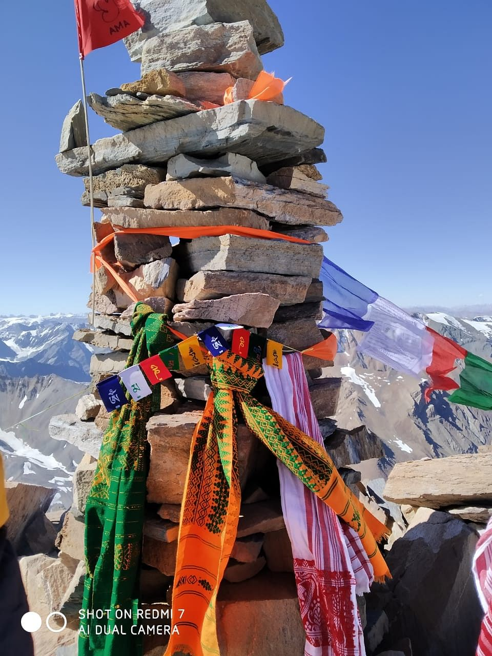 The traditional Bodo 'aronai' (scarf) and Assamese 'gamosa' finding a place on the 6,111-metre unnamed peak in Himachal Pradesh