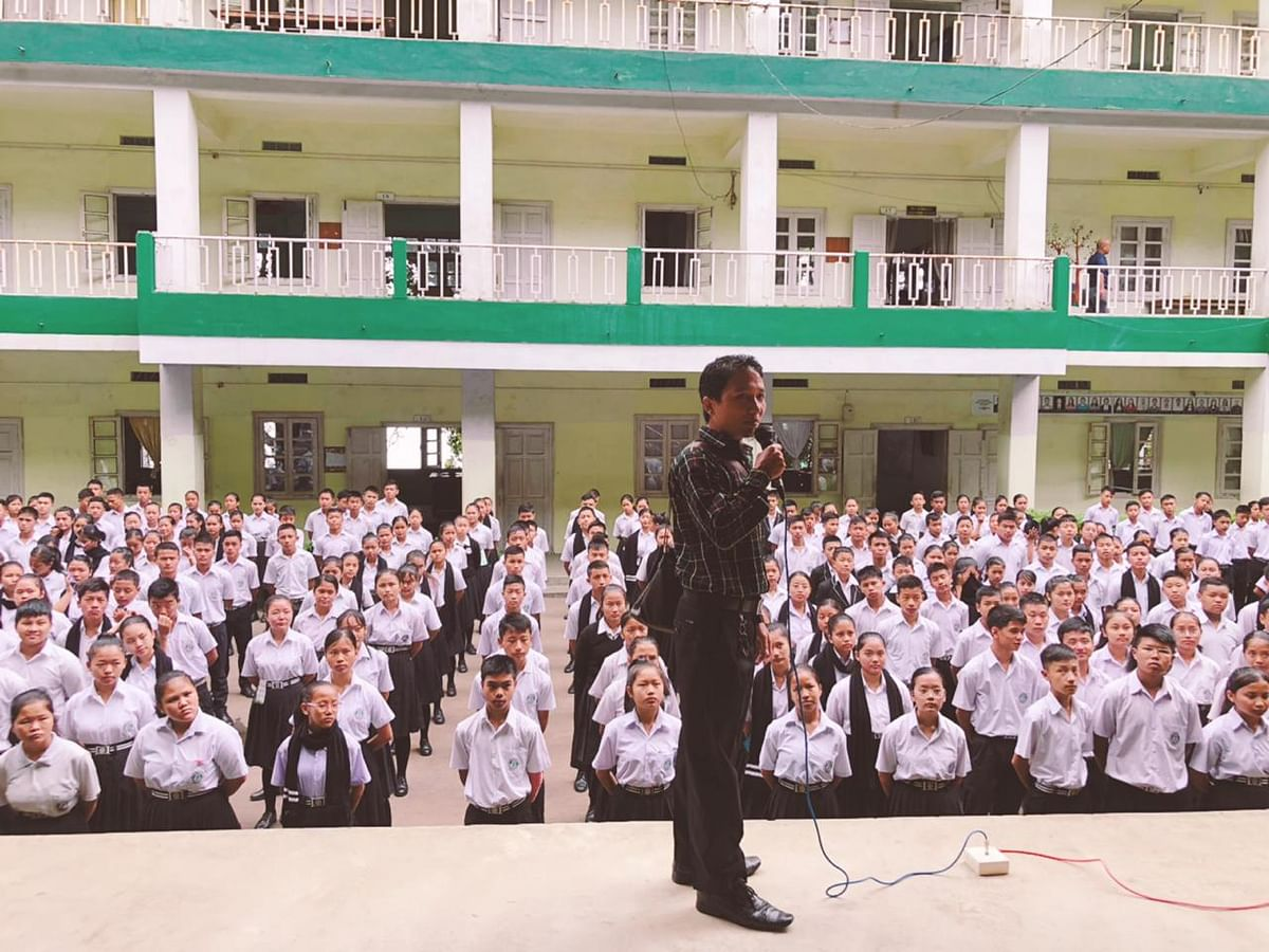 Students of a school in Aizawl taking a pledge administered by Mizo Zirlai Pawl leaders on Monday