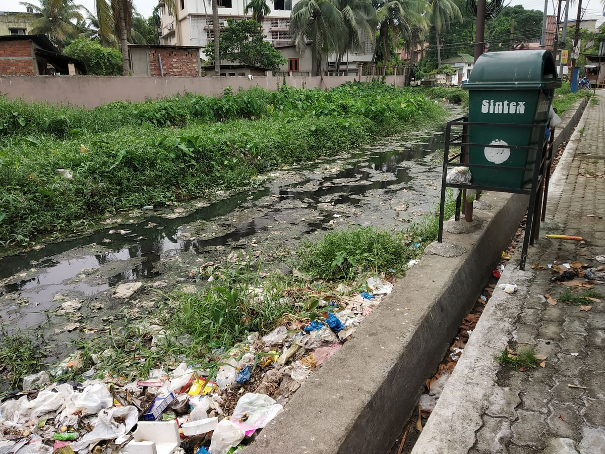 Bahini river, as the upper stretch of Bharalu is called, overflowing with garbage near Bormotoria in Guwahati