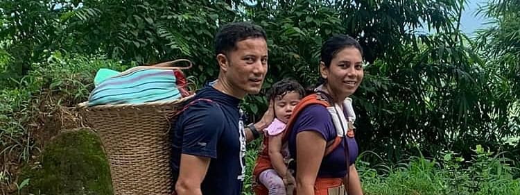Meghalaya's West Garo Hills DC Ram Singh walking to the local market with his wife and kid