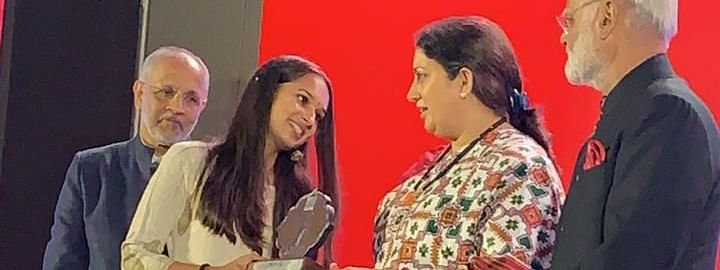 Akshar Forum founder Paramita Sarma receiving the Devi Award from Union minister Smriti Z Irani