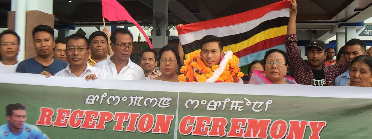 Indian hockey midfielder Chinglensana Singh Kangujam was given a resounding welcome by families and friends in Imphal, Manipur