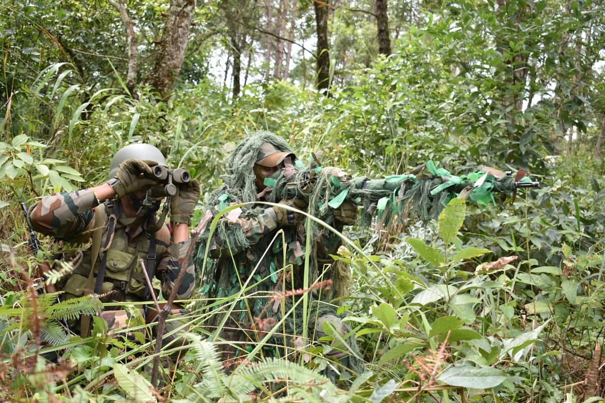 Troops of the Indian Army and Royal Thailand Army being trained on jungle survival techniques