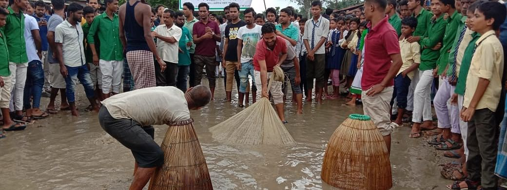 Protesters fishing with fishing nets and traps in the middle of the Kokrajhar-Bilashipara road in Assam