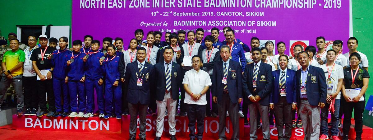 Members of top three team champions (senior category) with Sikkim chief minister PS Golay and officials of Badminton Association of Sikkim