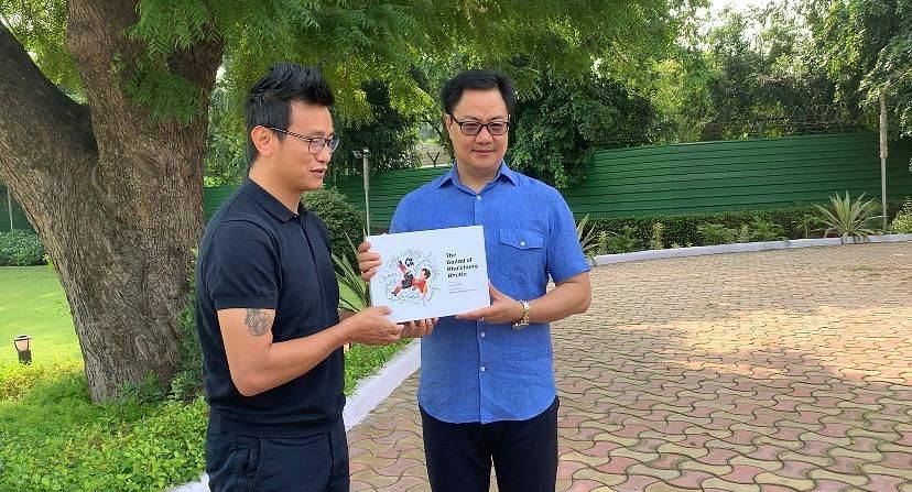 Union minister of state Kiren Rijiju (right) and Bhaichung Bhutia with the new coffee table book, 'The Ballad of Bhaichung Bhutia'