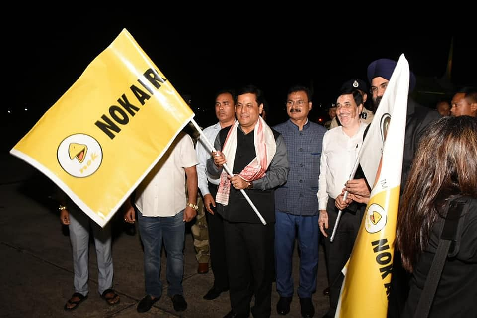 Assam CM Sarbananda Sonowal flagging off Nok Air's first Guwahati-Bangkok flight in Guwahati Airport