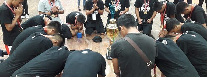 Mizoram team kneeling down in prayers after their victory over Punjab at the 46th National Sub-Junior Basketball Championship held in Odisha recently