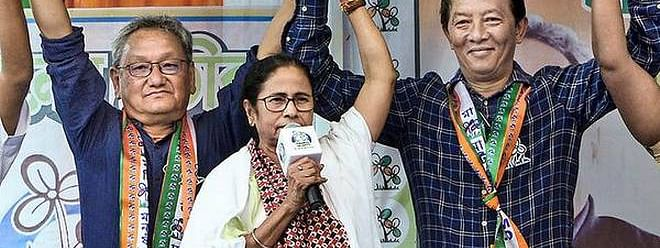 West Bengal CM Mamata Banerjee with TMC MP candidate Amar Singh Rai (left) and Binay Tamang (right)