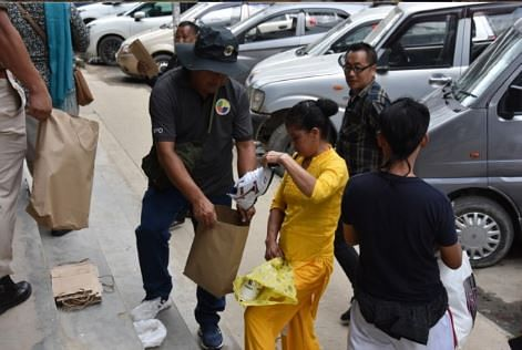 District authorities distributing paper bags to pedestrians in Kohima town of Nagaland