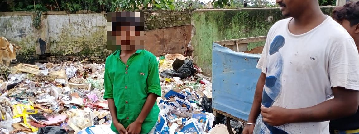 A child labourer caught by civic body personnel throwing garbage generated by a pizza outlet in Dibrugarh in Assam