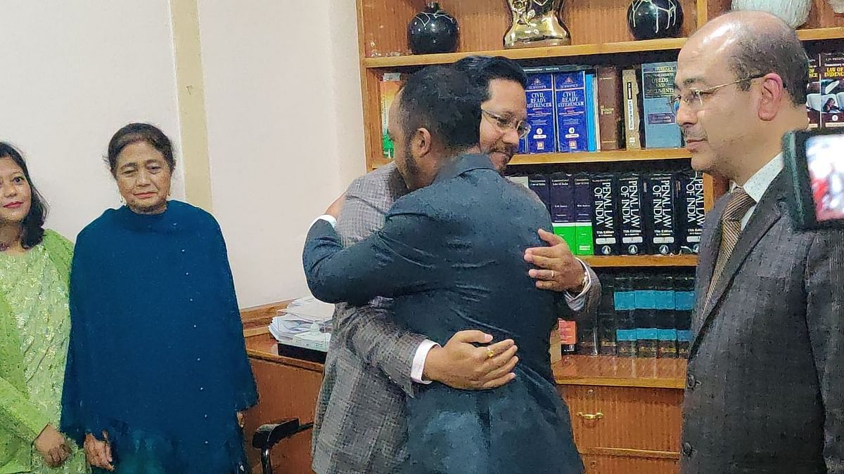 Balajied Kupar Synrem being congratulated by Meghalaya CM Conrad K Sangma after he was sworn in as an MLA from Shella constituency