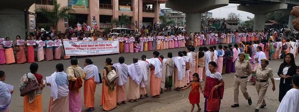 Women make human chain against the ongoing Naga peace talks in Imphal on Thursday