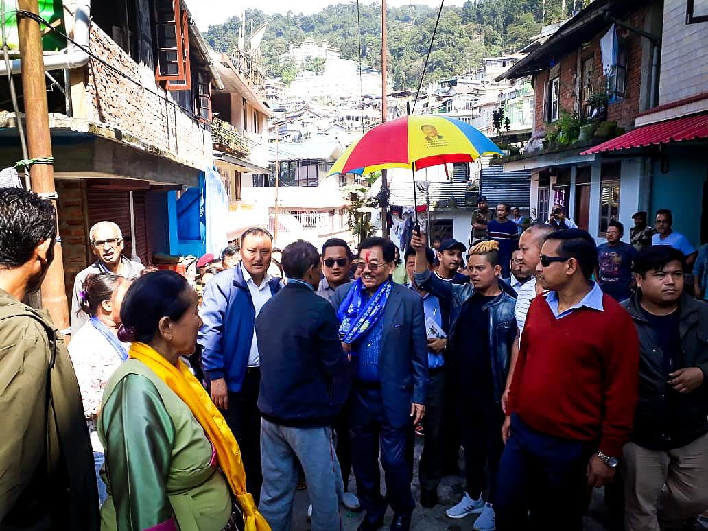 Former Sikkim CM Pawan Kumar Chamling campaigning for SDF candidate Moses Rai in South Sikkim